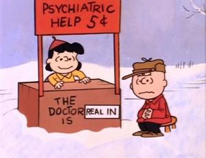 Lucy et Charlie Brown au kiosque de conseils psychologiques de Lucy.