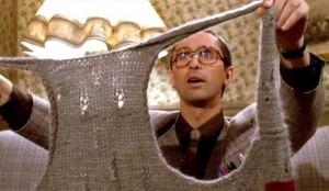 Pierre regarde son nouvau gilet, dans Le père Noël est une ordure.