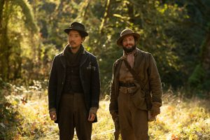 "FIRST COW - Orion Lee (left) as ""King-Lu"" and John Magaro (right) as ""Cookie"""